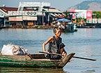 Tonle Sap Siem Reap Cambodian-woman-steering-her-boat-01.jpg