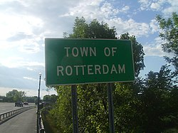 A sign depicting the entrance to town of Rotterdam on New York State Route 5