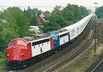 TraXion MY1134 and MY1110 pull a train of Maersk Sealand containers near Vejle, Denmark, in 2001