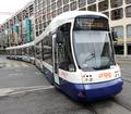 Tram approaches Geneve Cornavin station in Geneva Switzerland.png