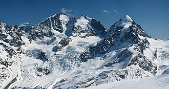 Eastern Alps - Piz Bernina (centre-left) with the Biancograt to the left, Piz Scerscen (centre-right) and Piz Roseg (right), seen from Piz Corvatsch