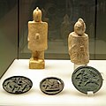Two clay gladiator statuettes and three bronze medallion with relief of gladiators, Romisch-Germanisches Museum, Cologne (8119455642).jpg