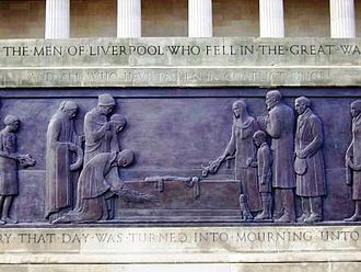 Liverpool Cenotaph - Detail from bronze sculpture depicting mourners laying wreaths on the Stone of Remembrance