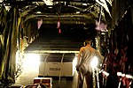 U.S. Air Force Tech. Sgt. Adam Nixon, a C-130H Hercules aircraft loadmaster assigned to the 746th Expeditionary Airlift Squadron, lowers a ramp so cargo may be unloaded at Pakistan Air Force Base Chaklala 100822-F-KV470-050.jpg