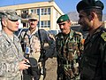 U.S. Army Command Sgt. Maj. William J. Gainey and Afghan Command Sgt. Maj. Roshan Safi along with fellow service members.jpg
