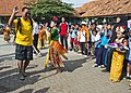 U.S. Navy Senior Chief Damage Controlman James Guieb, front left, dances with a member of an Indonesian dance team during a community service event for exercise Cooperation Afloat Readiness and Training (CARAT) 130522-N-IY633-028.jpg
