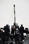 U.S. Sailors aboard the guided missile cruiser USS Lake Champlain (CG 57) raise a flag as the ship makes its way into port during Trident Fury 2013 in Vancouver, British Columbia, Canada, April 26, 2013 130426-N-ZZ999-011.jpg