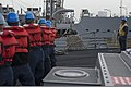 U.S. Sailors prepare to receive a refueling rig aboard the guided missile destroyer USS Ramage (DDG 61) in the Mediterranean Sea Oct. 2, 2013, during a replenishment at sea with the fleet replenishment oiler 131002-N-VC236-028.jpg