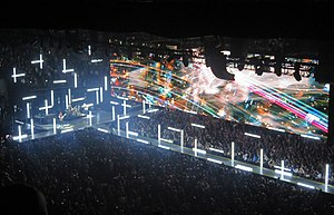 "Innocence + Experience Tour - The set's ""caged tube"" light fixtures, meant to resemble fluorescent lights, appeared to form crosses which when oriented horizontally and vertically."
