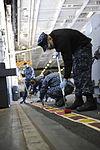 USS Nimitz sailors touch-up the hangar bay 120319-N-RC246-004.jpg