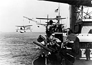 USS Tuscaloosa hoists a Curtiss SOC scout plane, September 1941