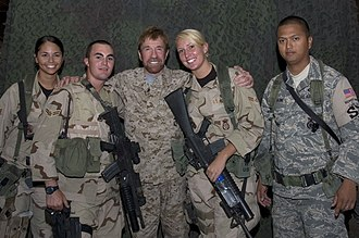 United States Air Force Security Forces - Chuck Norris, a former Air Policeman, poses with airmen of the 386th Air Expeditionary Wing's Security Forces.