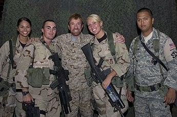 Chuck Norris, a former Air Policeman, poses with airmen of the 386th Air Expeditionary Wing's Security Forces US Air Force 070913-F-6470S-007 Chuck Norris visit deployed Airmen.jpg