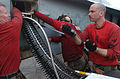 US Navy 030321-N-9712C-027 Aviation Ordnancemen load 50.caliber rounds into the nose cannon of an F-A-18 Hornet.jpg
