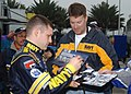 US Navy 040214-N-1126D-002 Casey Atwood, driver of the Navy's Busch-series NASCAR, signs autographs for NASCAR fans.jpg