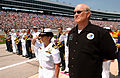US Navy 040403-N-5862D-071 Lt. Cmdr. Heather Pouncey, Navy Recruiting Command's Motorsports Division Officer and Terry Bradshaw, National Football League (NFL) sports legend and co-owner of the Navy sponsored Fitz-Bradshaw NASC.jpg