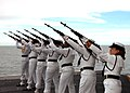 US Navy 040909-N-6264H-001 Sailors assigned to the Ceremonial Honor Guard aboard the aircraft carrier USS Carl Vinson (CVN 70) render a 21-gun salute for a burial at sea ceremony.jpg