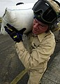 US Navy 050103-N-4166B-290 A Senior Chief Petty Officer, assigned to USS Abraham Lincoln (CVN 72), transfers relief supplies from a truck to an awaiting helicopter.jpg