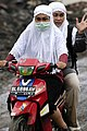 US Navy 050114-N-4166B-031 Indonesian Women on a motorcycle ride back from their home that was destroyed due to the Tsunami that struck in Banda Aceh, Sumatra, Indonesia.jpg