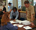 US Navy 060317-N-5275S-037 Senior Chief Kevin Fuhs, assigned to Expeditionary Warfare Training Group Atlantic helps a woman register for a bone marrow drive at Naval Amphibious Base Little Creek.jpg