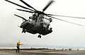 US Navy 060430-N-9866B-042 A CH-53 Super Stallion helicopter takes off from the flight deck aboard the amphibious assault ship USS Peleliu (LHA 5).jpg