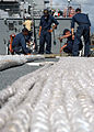 US Navy 070301-N-6674H-026 Sailors aboard guided missile destroyer USS Hopper (DDG 70) secure the large towing hawser line to the flight deck in preparation for an underway-towing evolution.jpg