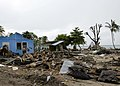 US Navy 070413-N-4790M-015 Residents try to salvage materials from houses destroyed by an earthquake and resulting tsunami.jpg