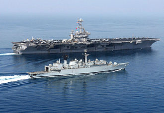 Plane guard - A British frigate providing plane guard support to a US aircraft carrier