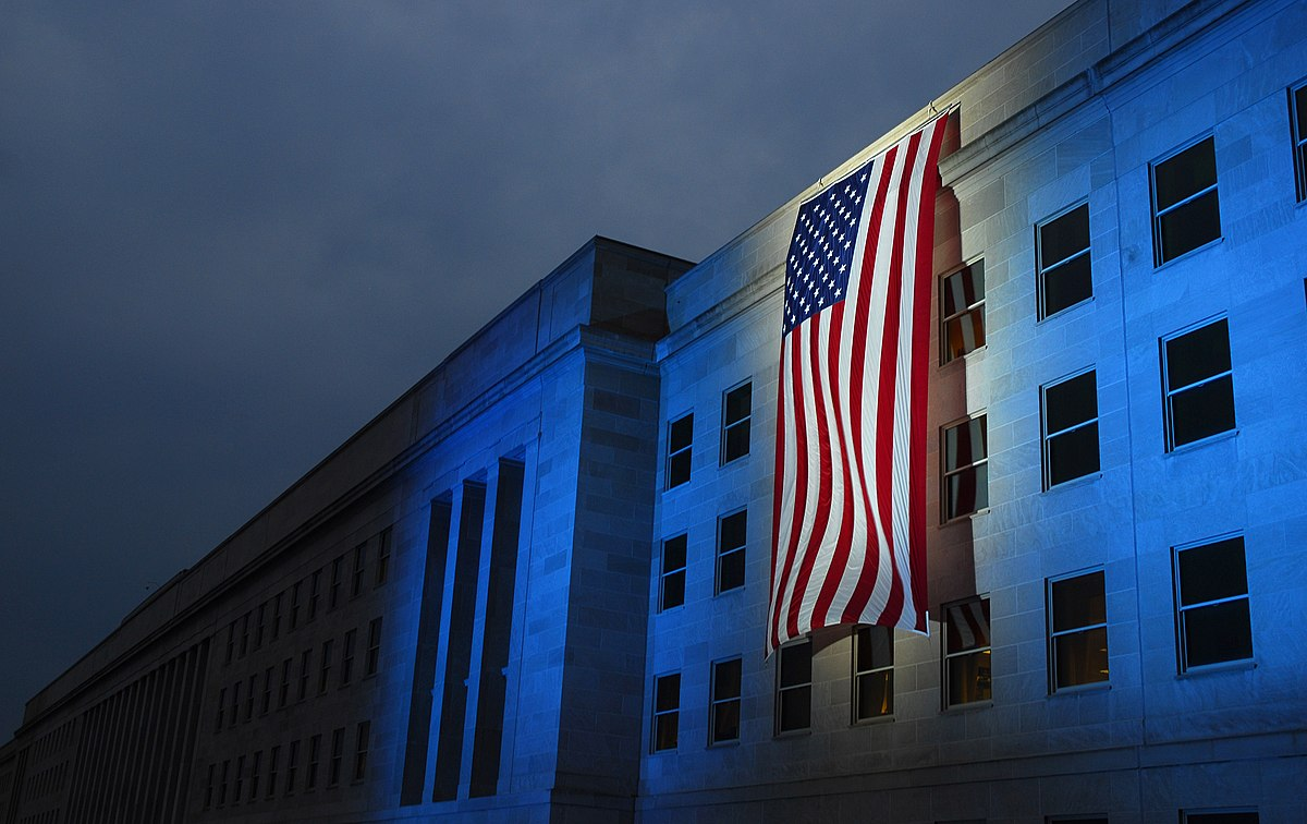 From a photo release from the U.S. Navy in 2007: WASHINGTON (Sept. 11, 2007) - A memorial flag is illuminated near the spot where American Airlines Flight 77 crashed into the Pentagon on Sept. 11, 2001. Secretary of Defense Robert Gates is scheduled to host the Pentagon Sept. 11 Memorial observance for family members of those who were killed in the Sept. 11 attack on the Pentagon. U.S. Navy photo by Mass Communication Specialist 1st Class Brandan W. Schulze (RELEASED)