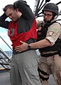 US Navy 071202-N-2838W-143 A member of the guided-missile destroyer USS Bulkeley's (DDG 84) visit, boarding, search and seizure team searches one of the acting suspect crewsman during their simulation boarding aboard the traini.jpg