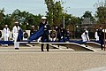 US Navy 080911-D-7203C-014 Members of an honor guard consisting of 184 joint service troops unveil the Pentagon Memorial in Washington as the United States Air Force Band plays.jpg