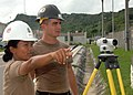 US Navy 080929-N-8816D-003 Chief Engineering Aid Majellen Quezon use an auto-level to take readings from a large measuring stick.jpg