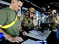 US Navy 090526-N-5345W-125 Marines assigned to the visit, board, search and seizure team review the ship's manifest and charts in the bridge with simulated crew members during a non-compliant merchant vessel drill.jpg