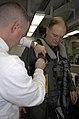 US Navy 100205-N-2475A-049 Aircrew Survival Equipmentman 1st Class Michael Kraus, left, from Mesa, Ariz., assists Capt. Joseph W. Kuzmick.jpg