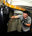 US Navy 100307-N-7939W-014 Aviation Electrician's Mate 3rd Class Ryan Jones trains with a punching bag aboard the aircraft carrier USS Nimitz (CVN 68).jpg