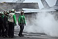 US Navy 100426-N-5749W-468 Sailors aboard the aircraft carrier USS Abraham Lincoln (CVN 72) await the launch of an F-A-18C Hornet, assigned to the Vigilantes of Strike Fighter Squadron (VFA) 151.jpg