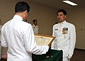 US Navy 100611-N-6920A-053 Rear Adm. Yasushi Matsushita, Chief of Staff of the Self-Defense Fleet, presents a letter of appreciation to U.S. 7th Fleet Command Master Chief Marcos Sibal.jpg