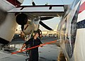 US Navy 100902-N-1092P-784 Aviation Structural Mechanic 3rd Class Bianca Islas ses a wash-stick to clean a C-2A Greyhound during a post-flight wash-down.jpg