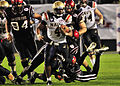 US Navy 101223-N-1722W-182 U.S. Naval Academy quarterback Ricky Dobbs (^4), tries to get past San Diego State University defenders during the 2010.jpg
