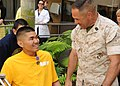 US Navy 110414-N-CW427-023 Hospital Corpsman 3rd Class Stuart Y. Fuke s congratulated after being presented the Purple Heart medal.jpg