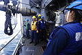 US Navy 110514-N-DU438-311 Sailors aboard the guided-missile cruiser USS Gettysburg (CG 64) stand by as a fueling hose is detached during a repleni.jpg
