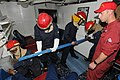 US Navy 110812-N-DU438-132 Machinery Repairman 1st Class Brandon Woodard, right, supervises as Sailors place a metal shoring against a bulkhead dur.jpg