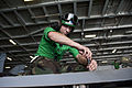 US Navy 111012-N-BT887-201 Aviation Structural Mechanic 2nd Class Michael Hinson, from Pineville, N.C., removes a fastener from the wing of an F-A.jpg