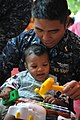 US Navy 111025-N-WW409-129 Ensign James Kim, assigned to the guided-missile destroyer USS Mustin (DDG 89), plays with a child at the Pattaya Orphan.jpg
