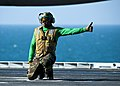 US Navy 111214-N-BT887-016 Aviation Boatswain's Mate (Equipment) 2nd Class Ashawn Robertson gives an approval to launch aircraft aboard the Nimitz.jpg