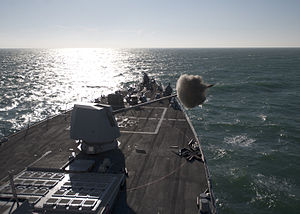 US Navy 120112-N-NL401-141 The guided-missile destroyer USS James E. Williams (DDG 95) fires the Mk-45 5-inch-62 caliber lightweight gun during a l.jpg