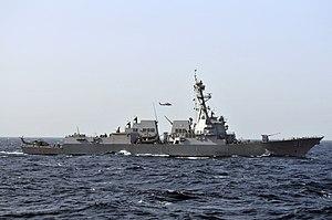 US Navy 120213-N-ZI635-590 The Arleigh Burke-class guided-missile destroyer USS Momsen (DDG 92) pulls alongside the Nimitz-class aircraft carrier U.jpg