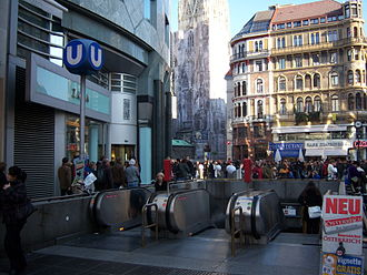 Stephansplatz (Vienna U-Bahn) - Station entrance in front of Haas-Haus with St. Stephen's in the background