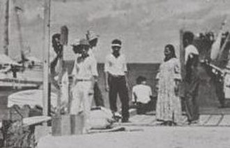 Amelia Earhart: The Lost Evidence - According to The Lost Evidence, the central woman facing the ocean was likely to be Earhart, and one of the men on the left likely Noonan.  The actual identities of the subjects of this picture are unknown.