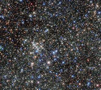 Pistol Star - The pistol star is the brightest star in this image of the Quintuplet cluster, just below centre.